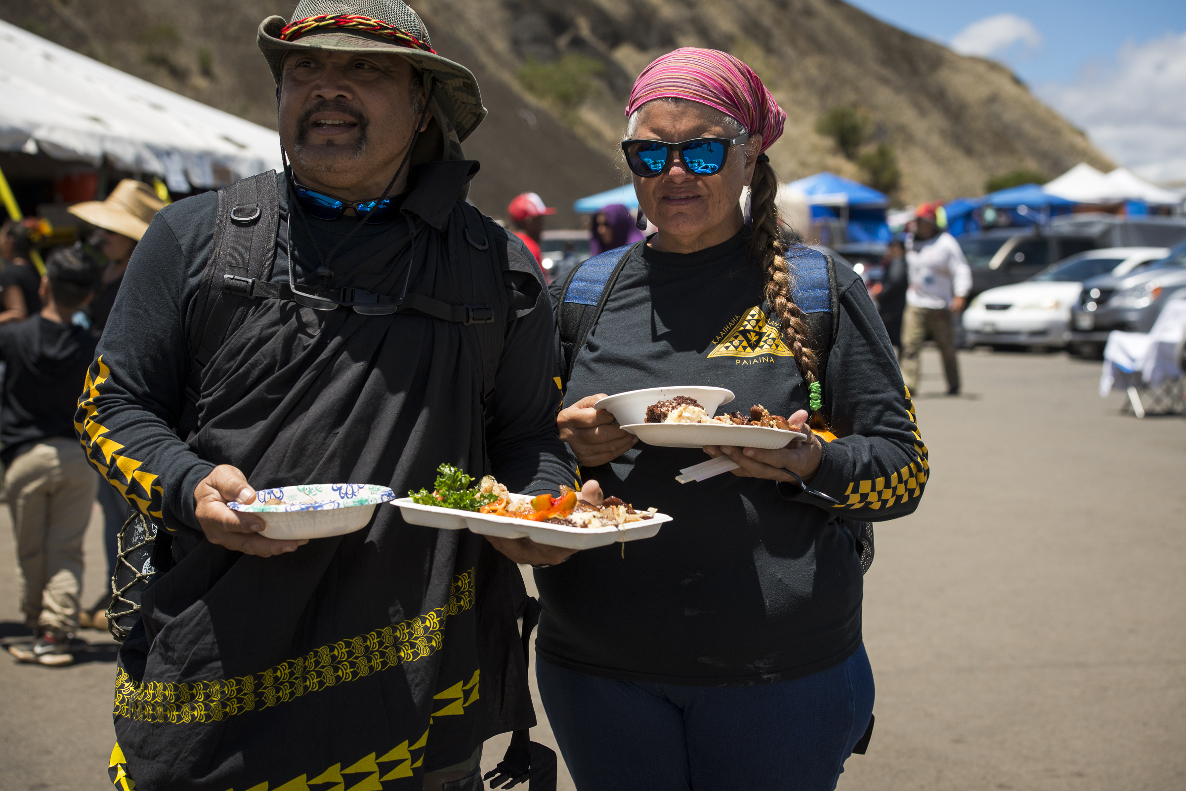 <p>Lunchtime for two of the activists who have congregated to try to prevent construction of another observatory near the summit of Mauna Kea, which some Native Hawaiians consider sacred.</p>