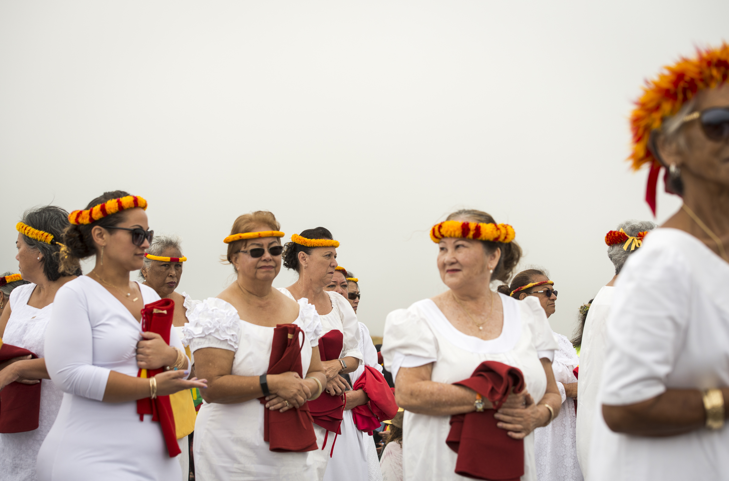 <p>Members of the Na Wahine Royal Order of Kamehameha prepare to perform Friday. Many organizations have sent representatives to address and entertain the protesters.</p>