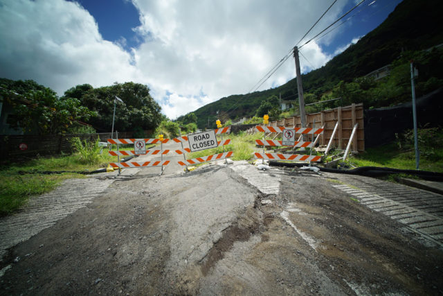 Portion of Kuahea Street is closed with barrier, No Pedestrian Access sign in Palolo Valley.