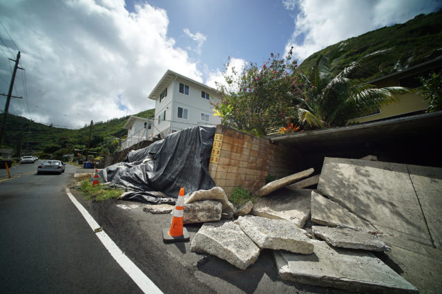 Debris along Waiomao Road after the Kaumea Street intersection. Some structures on Kaumea Street in Palolo have been demolished wih the ground still shifting causing homes below to continue to slide too.