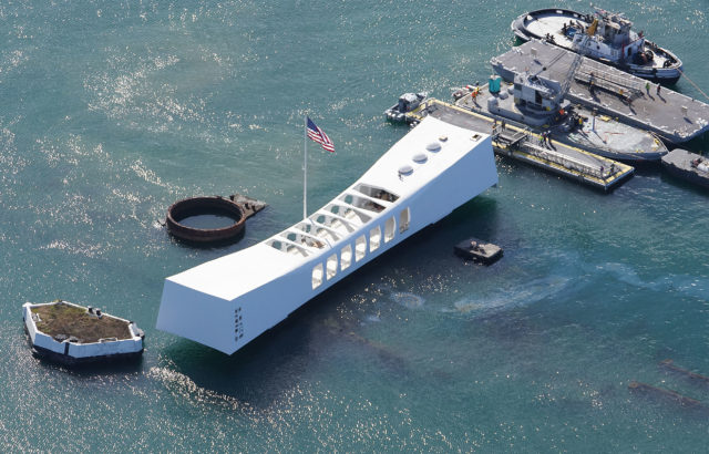 Joint Base Pearl Harbor Hickam USS Arizona Memorial with oil slick.
