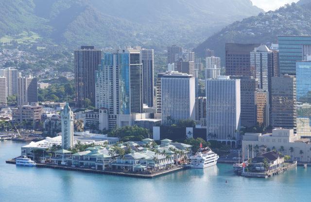 Downtown Honolulu buildings along Honolulu Harbor with Aloha Tower.