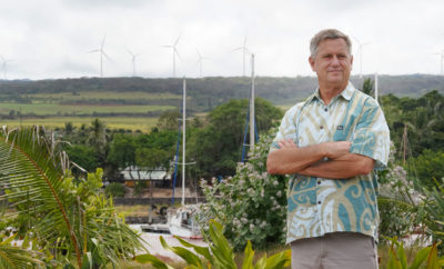 Senator Gil Riviere stands at Alii Park in Haleiwa with windmills above Waimea Bay.