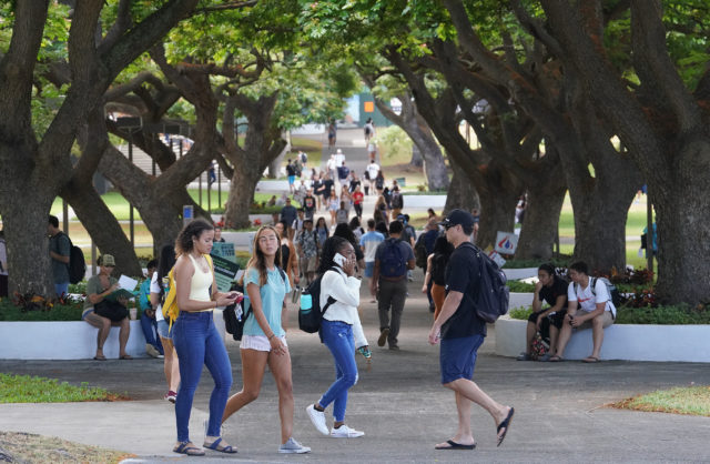 Students walk across the mall area of the University of Hawaii at Manoa on the first day of instruction.