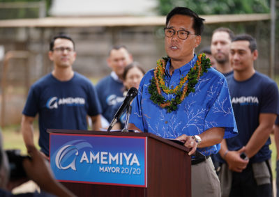 Keith Amemiya announces his candidacy for the office of Mayor at Ala Wai Field with his family and supporters.