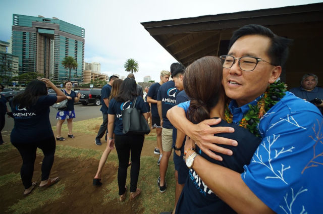 Keith Amemiya hugs supporters after announcing his candidacy for Mayor at Ala Wai Field.