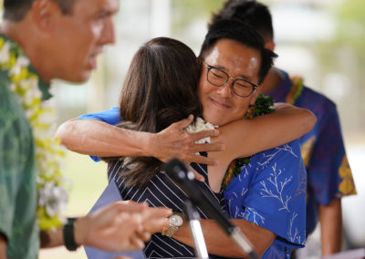 Keith Amemiya hugs his wife Bonny Amemiya before announcing his candidacy for Mayor of Honolulu at Ala Wai Park.