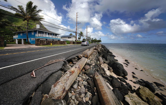 Damaged section of road on Kamehameha Highway in Kaaawa. Climate change.