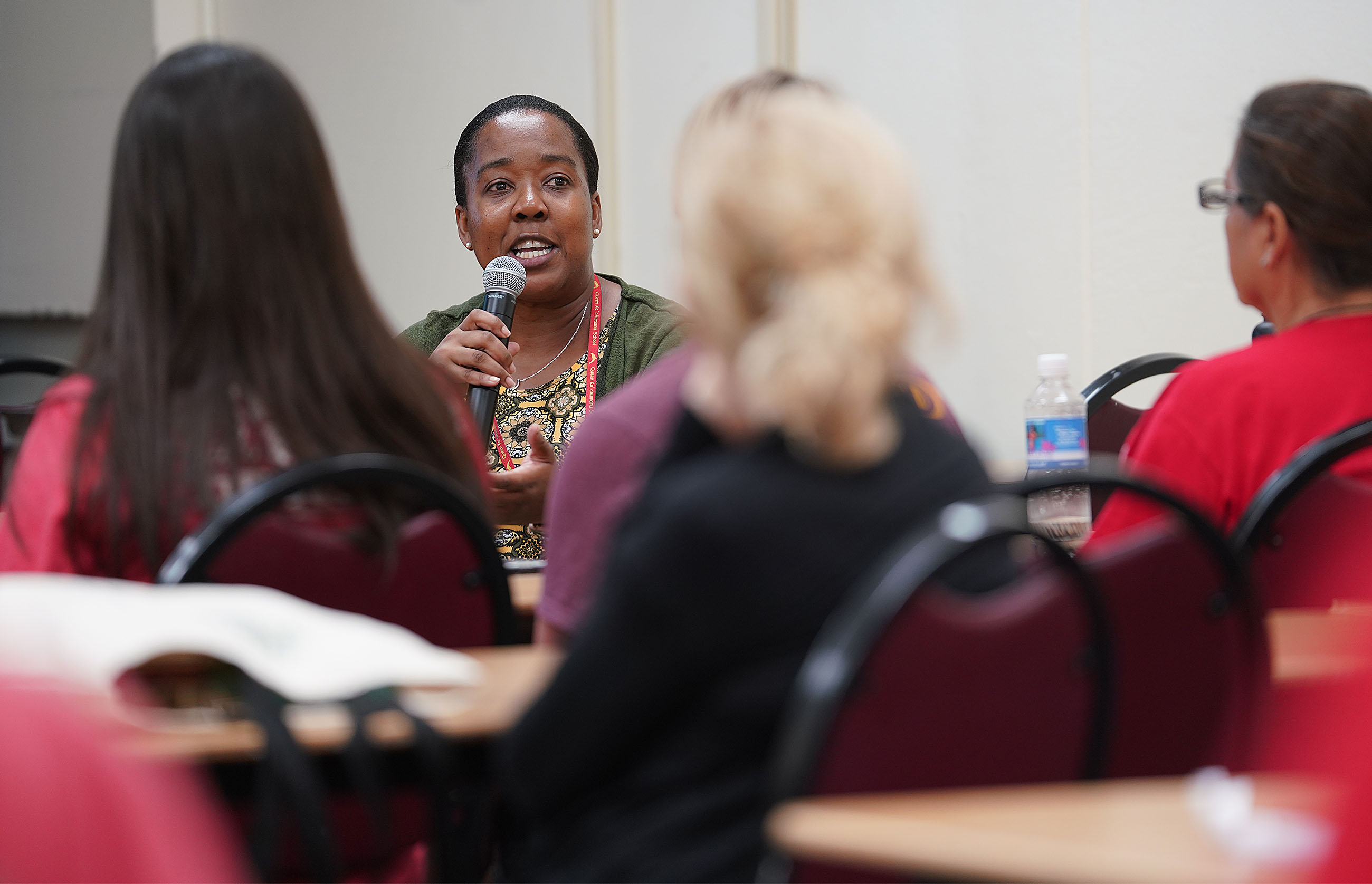 Queen Kaahumanu teacher Mary Bonnetty asks a question during salary session held at McKinley Adult School.