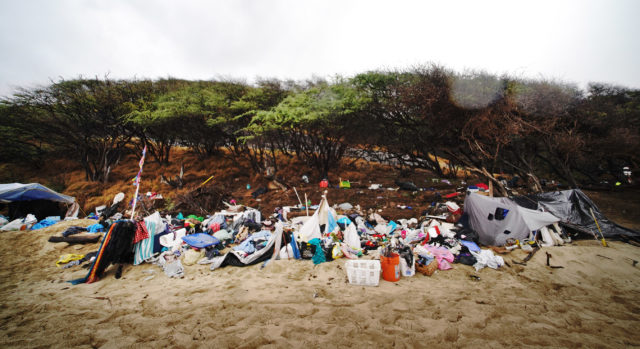 Crews cleanup Kuilei Cliffs Beach Park homeless tents and belongings.