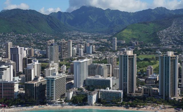 Waikiki Hotels and Waikiki Beach with Manoa in bkgd aerial 0369.