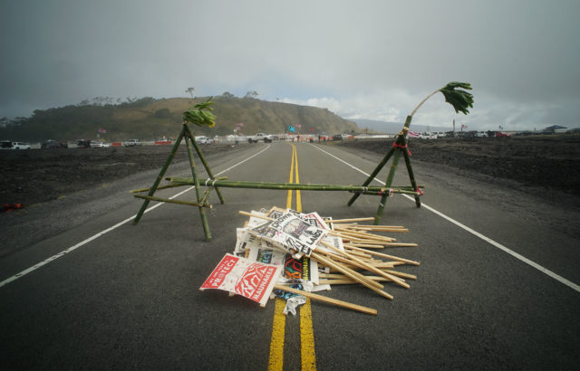 Pile of antiTMT protestor signs sits on the Mauna Kea Access Road after demonstrators found out that no arrests will be made today.