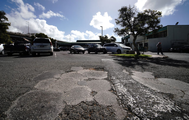 Market City Shopping Center badly patched parking area fronting Kaimuki Foodland.
