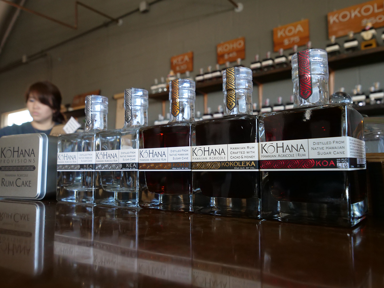 <p>A sampling of rum bottles line the bar of the Ko Hana distillery. Each rum is produced from a single variety of Hawaiian sugar cane.</p>