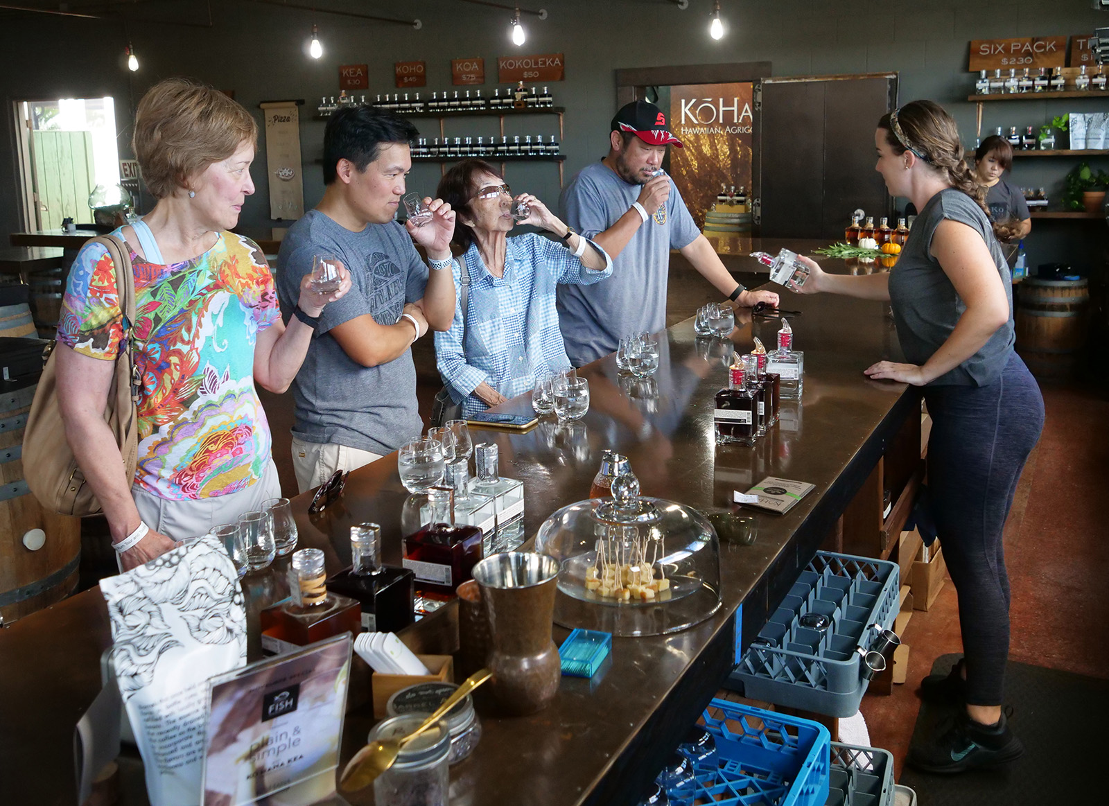 <p>Visitors sample four different varieties of rum produced at Ko Hana.</p>