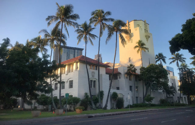Honolulu Hale bathed in sunrise light.