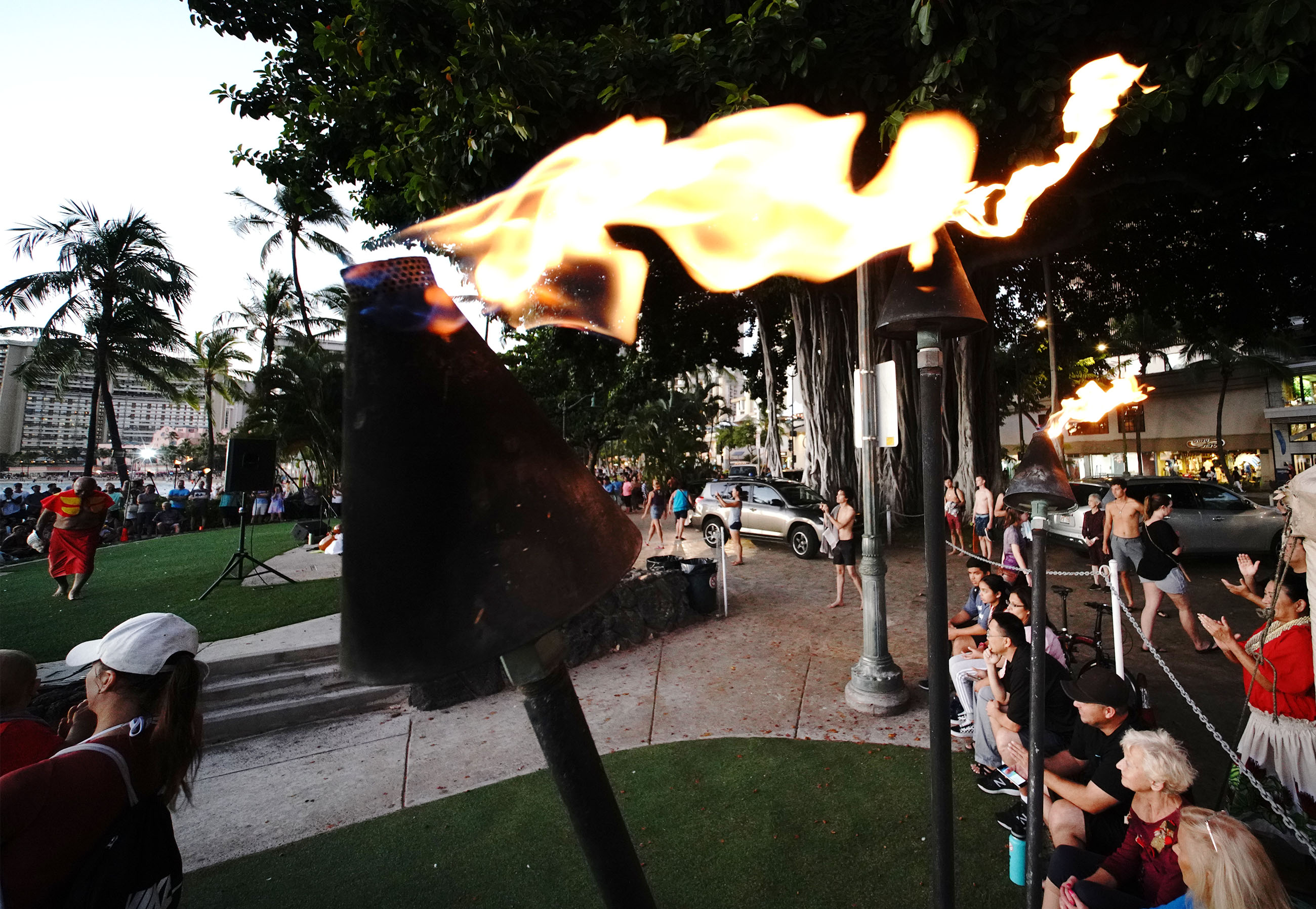 Gas Torches lit up near the Kuhio Beach Park hula mound.