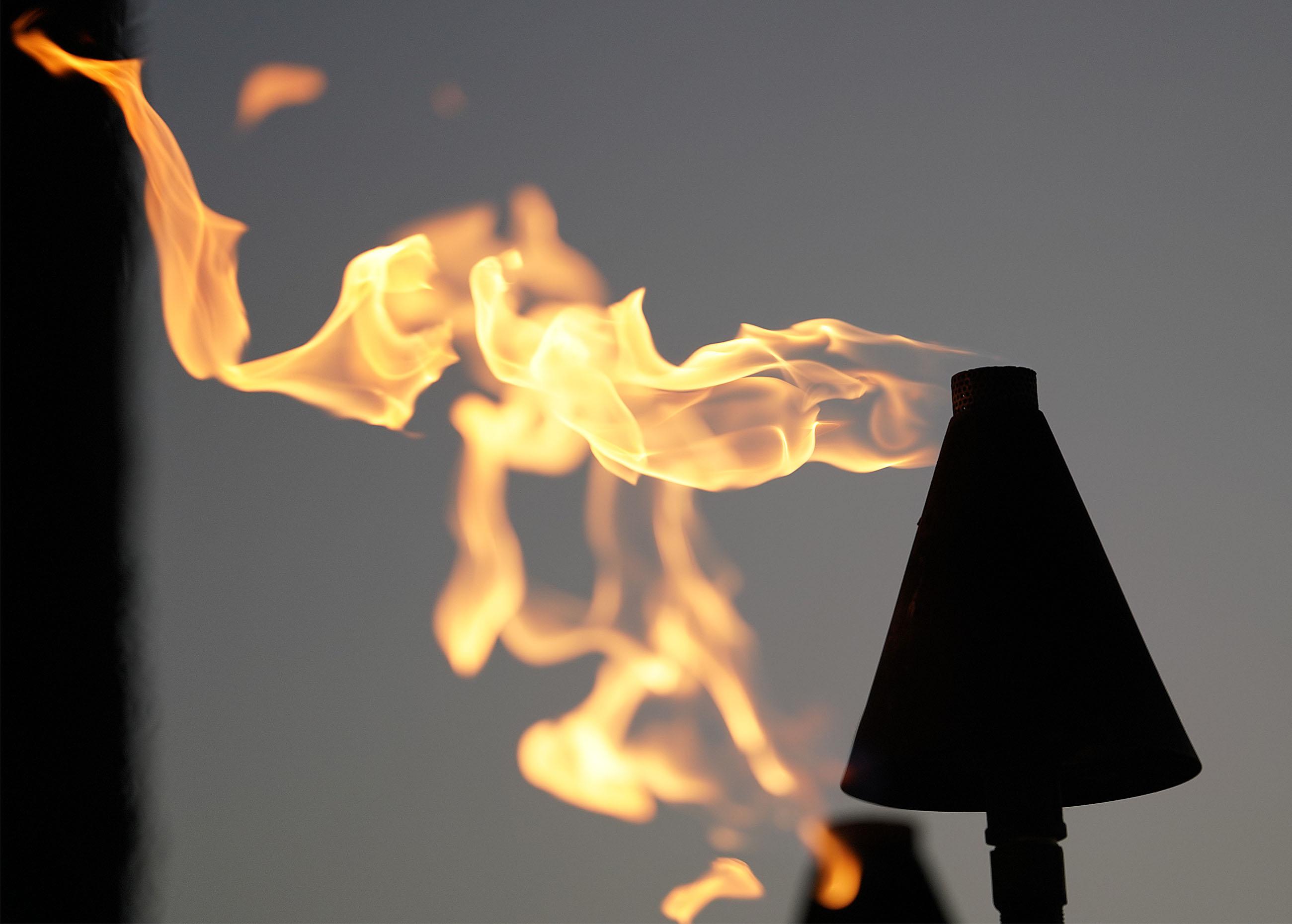 Gas torches near the Kuhio Beach Park hula mound.