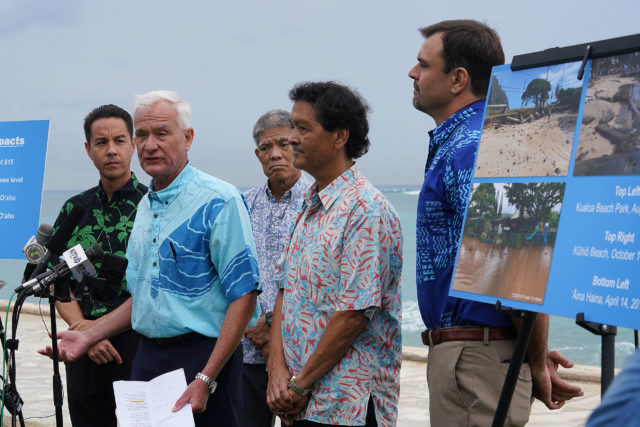 Mayor Kirk Caldwell announces lawsuit against large petroleum companies seeking damages for climate change at Waikiki Beach today.
