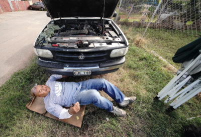 Sefo Fatai works on a truck in Waianae. Sefo works in masonry although he is a trained mechanic.