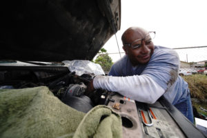 Sefo Fatai works on a truck in Waianae. Sefo is a trained auto mechanic although he works doing masonry.