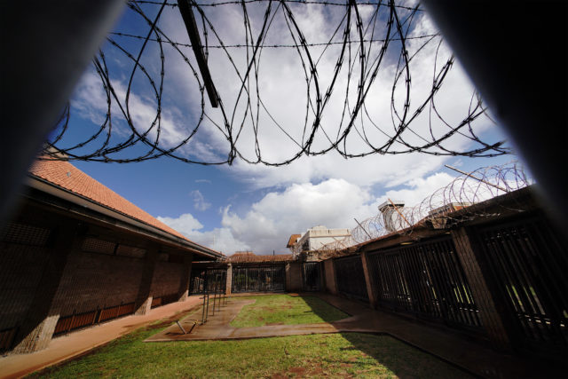 Oahu Community Correctional Center razor wire inside jail.
