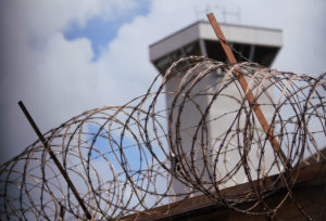 Oahu Community Correctional Center media tour 2019 tower with razor wire.
