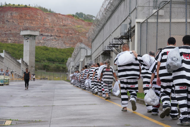 Halawa Correctional Facility inmates move along on main street back to their module.