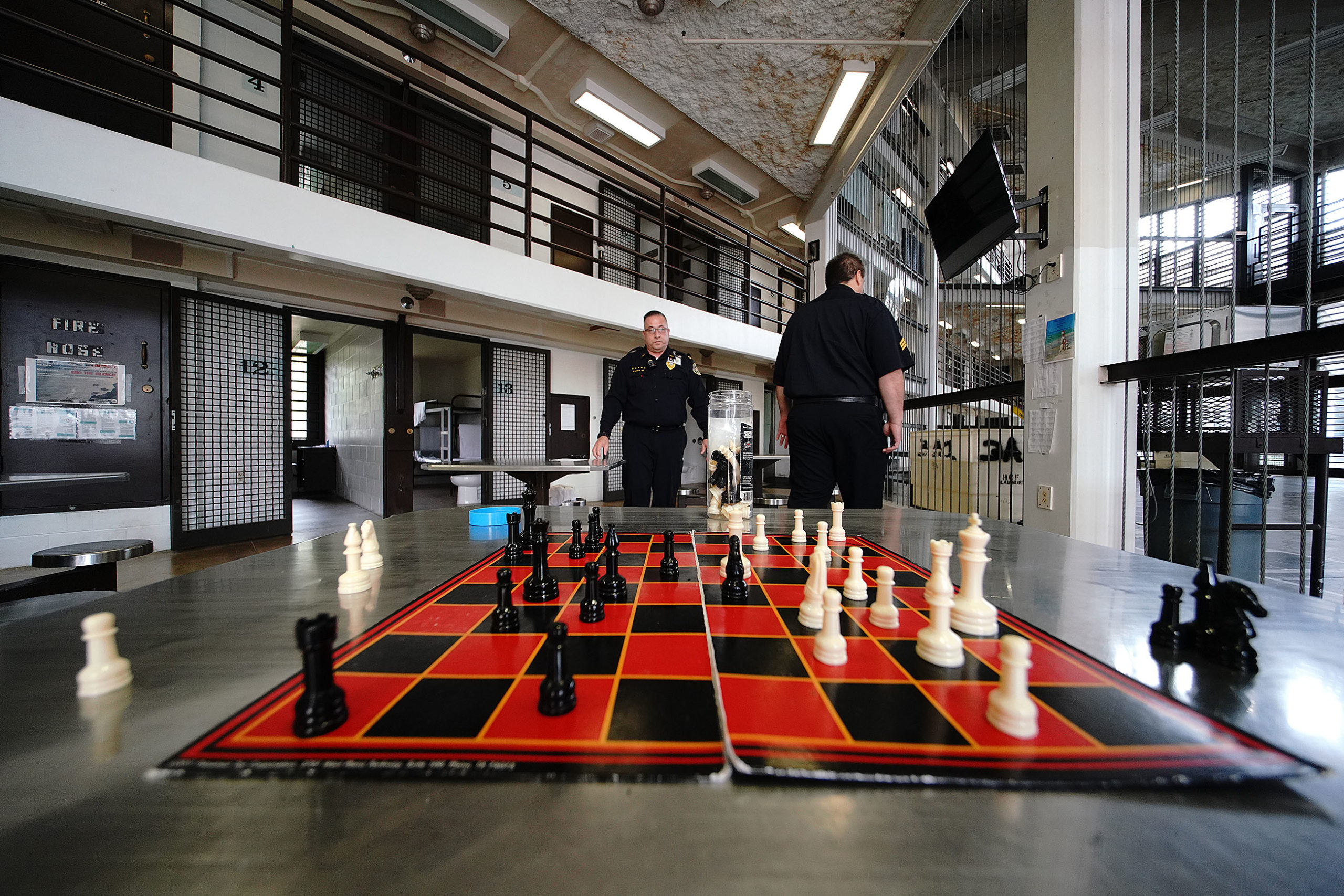 <p>This chess game was interrupted when the media was escorted into the module at Halawa. This particular module houses general population inmates, says Acting Chief of Security Calvin Mock. Halawa only houses convicted inmates and is not overcrowded, so Mock says the facility does not have to triple bunk.</p>