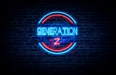 A blue and red neon sign on a brick wall that reads: GENERATION Z