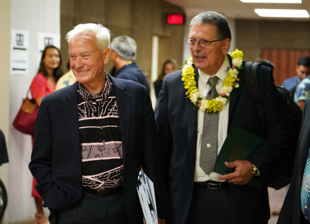 Mayor Kirk Caldwell greets Maui Mayor Mike Victorino before joint WAM Finance committee meeting 2020.