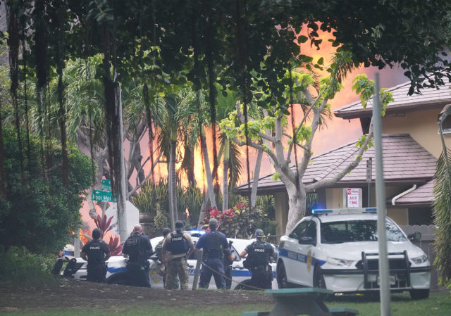 HFD and Honolulu Police Department officers respond to a shooting near La Pietra. Police watch as fire erupts from homes nearby.