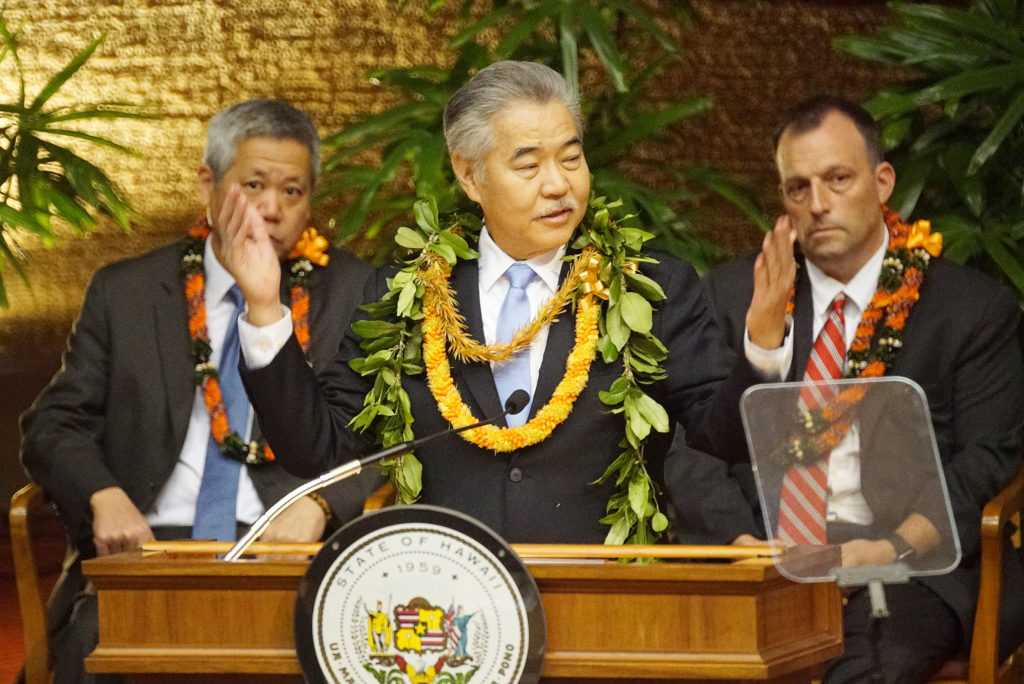 Governor David Ige State of the State address 2020 in the House chambers, Governor gestures for those responsible in getting focused on 2020 legislature to rise to be recognized.