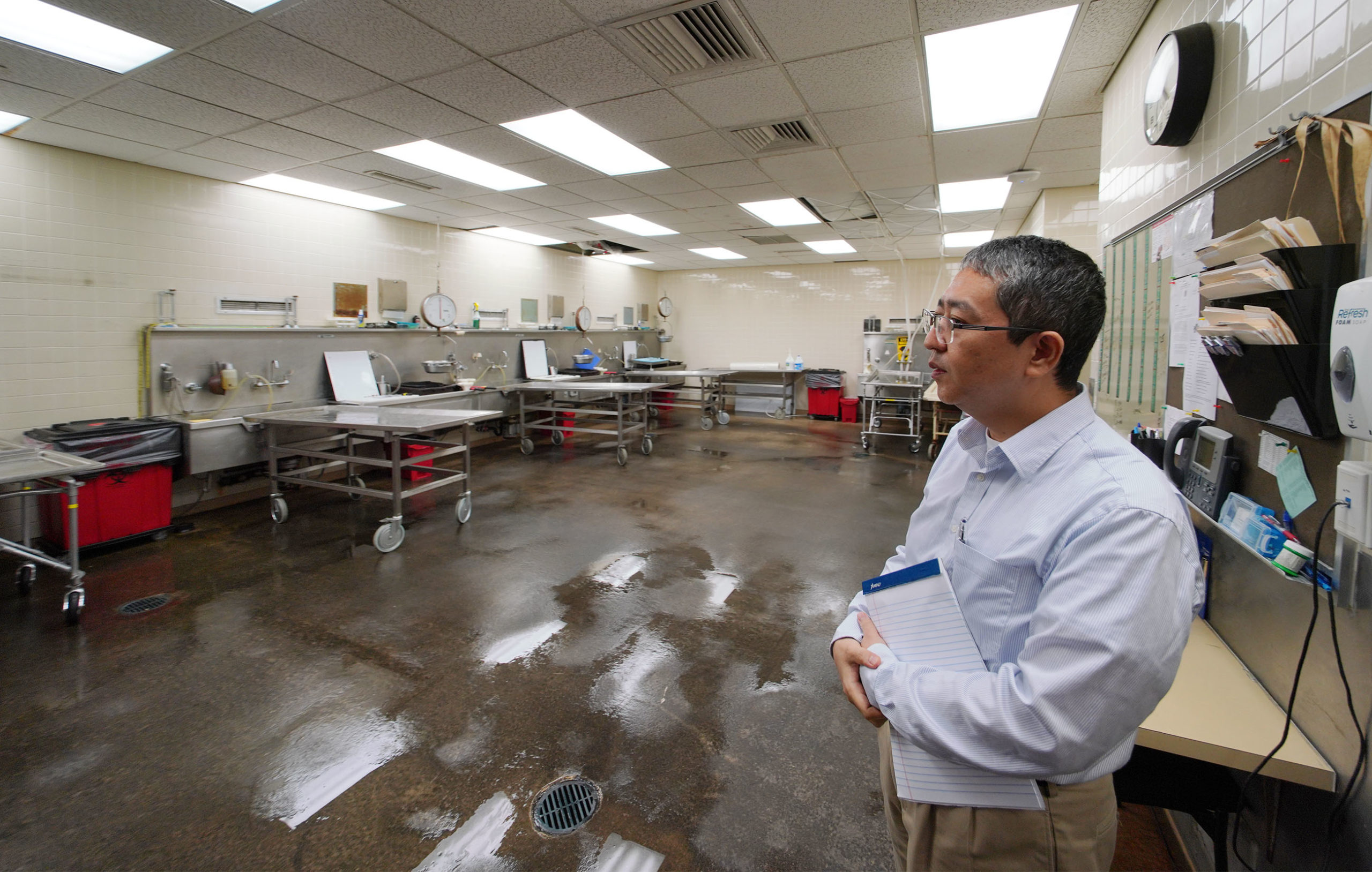 Medical Examiner Medical Examiner Dr Kobayashi stands in morgue.