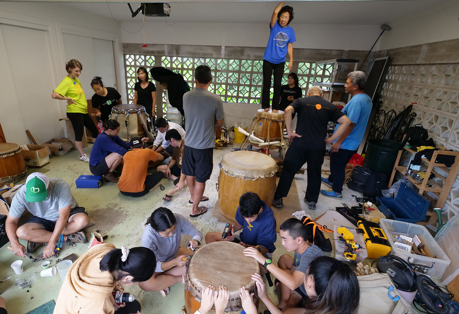 <p>Reskinning the taiko drums used for classes and performances by the Taiko Center of the Pacific is a group effort that requires many hands. The students and families of this community are eager to help as they gather together over two long days to repair and revitalize their instruments.</p>
