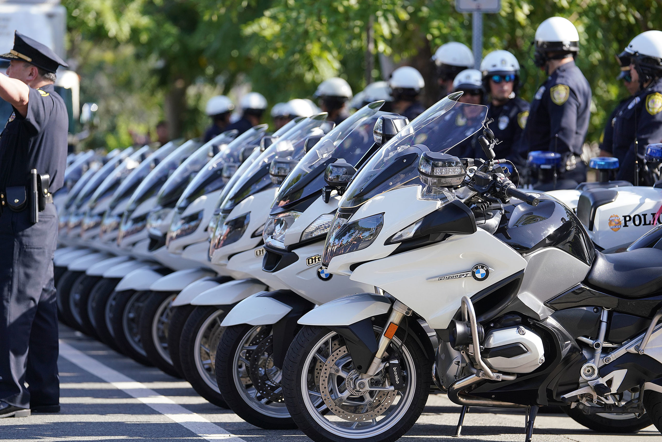 "<p>HPD officers parked their motorcycles in preparation for a ""pass and review,"" in which hundreds of law enforcement officers and public safety officials passed through the chapel where Enriquez's casket was resting to pay their respects.</p>"
