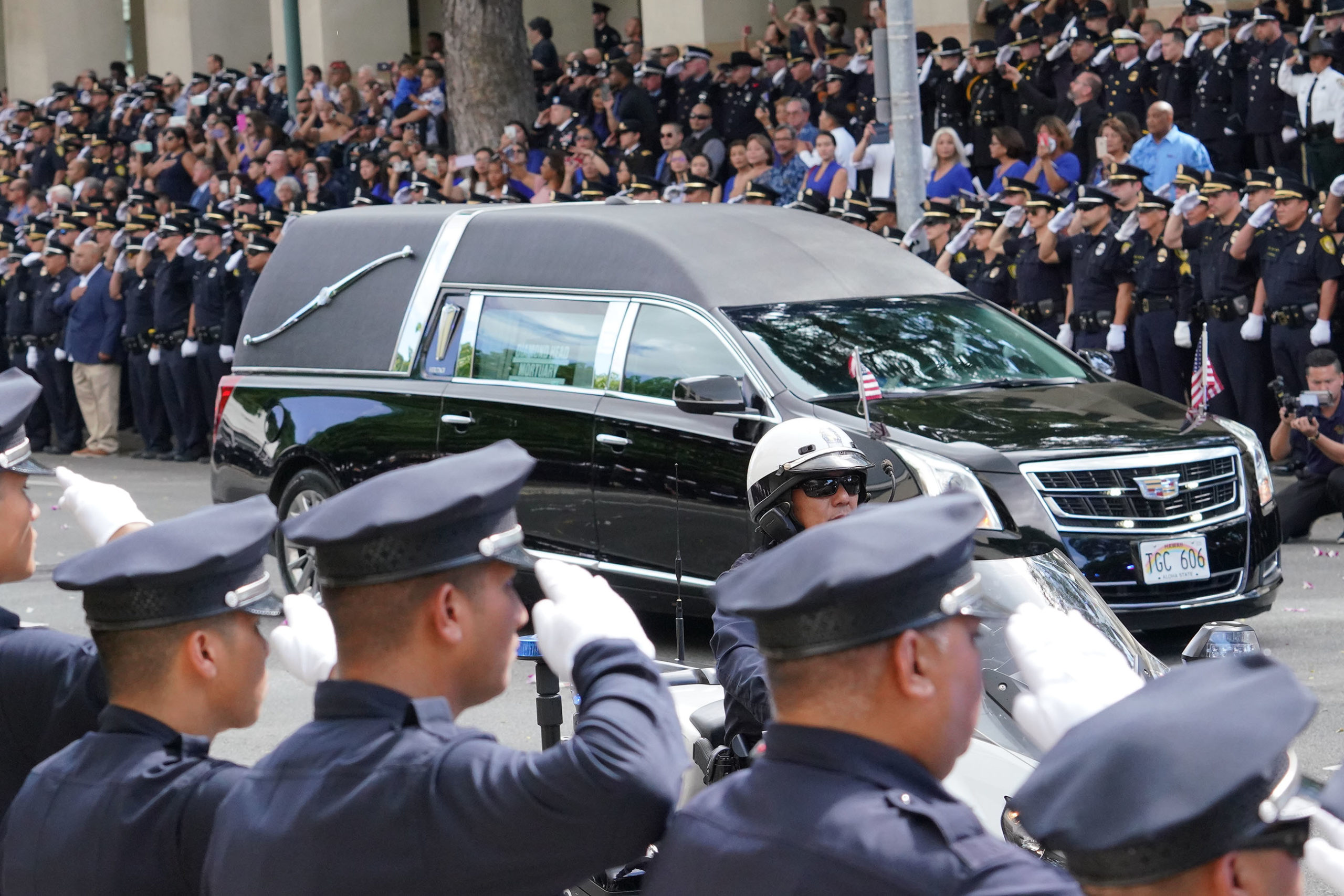 <p>A hearse carrying the casket of Officer Tiffany Enriquez arrived at HPD headquarters while a crowd of law enforcement, civilian workers and the public watched. It was followed by a limousine transporting family members of Enriquez, who were saluted by HPD officers.</p>