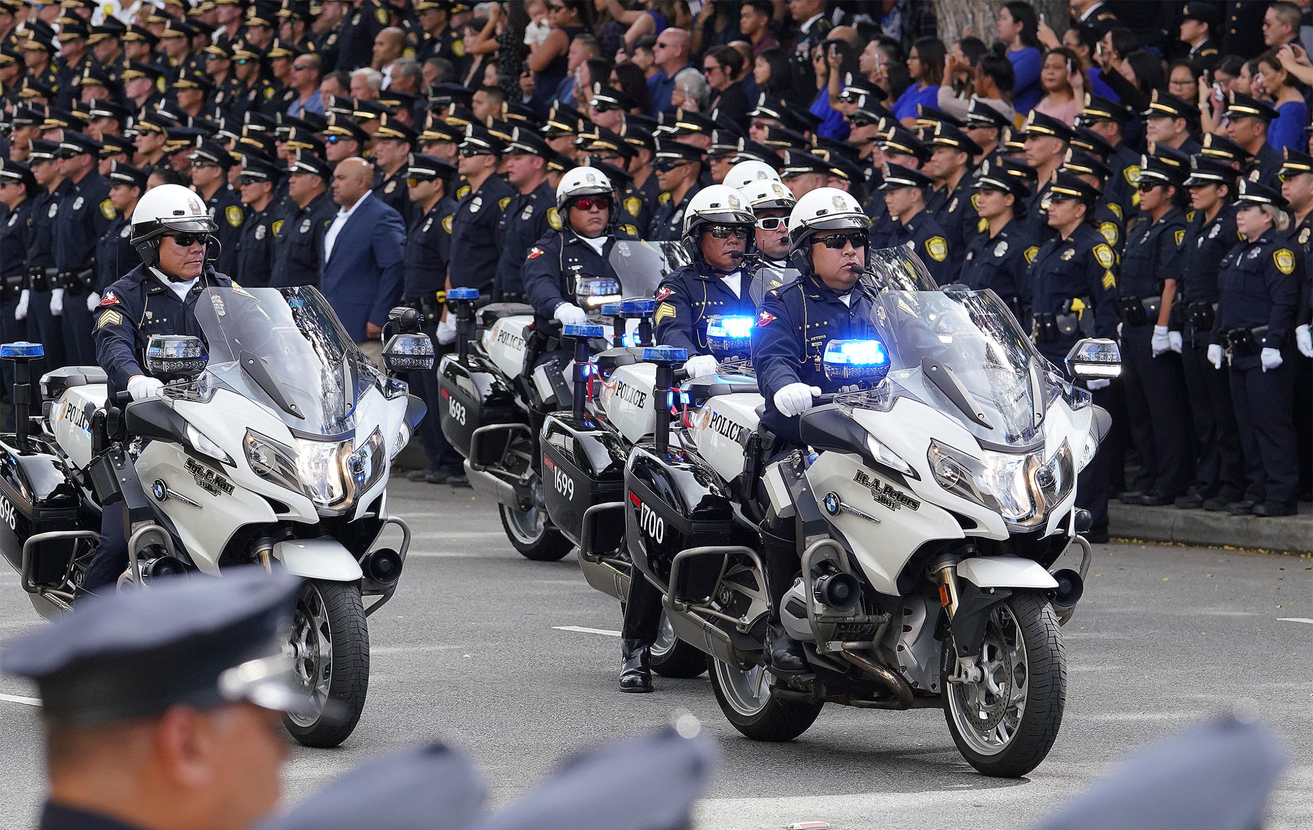 <p>A procession of vehicles arrived at the Honolulu Police Department headquarters at 801 S. Beretania St. Law enforcement personnel from not only Hawaii but across the country traveled to Honolulu, including those representing police departments in Aurora, Colo., Anaheim, Calif., Seattle and San Francisco.</p>