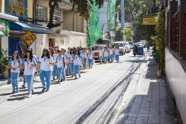 Group of students walking to school in Makati, Philippines