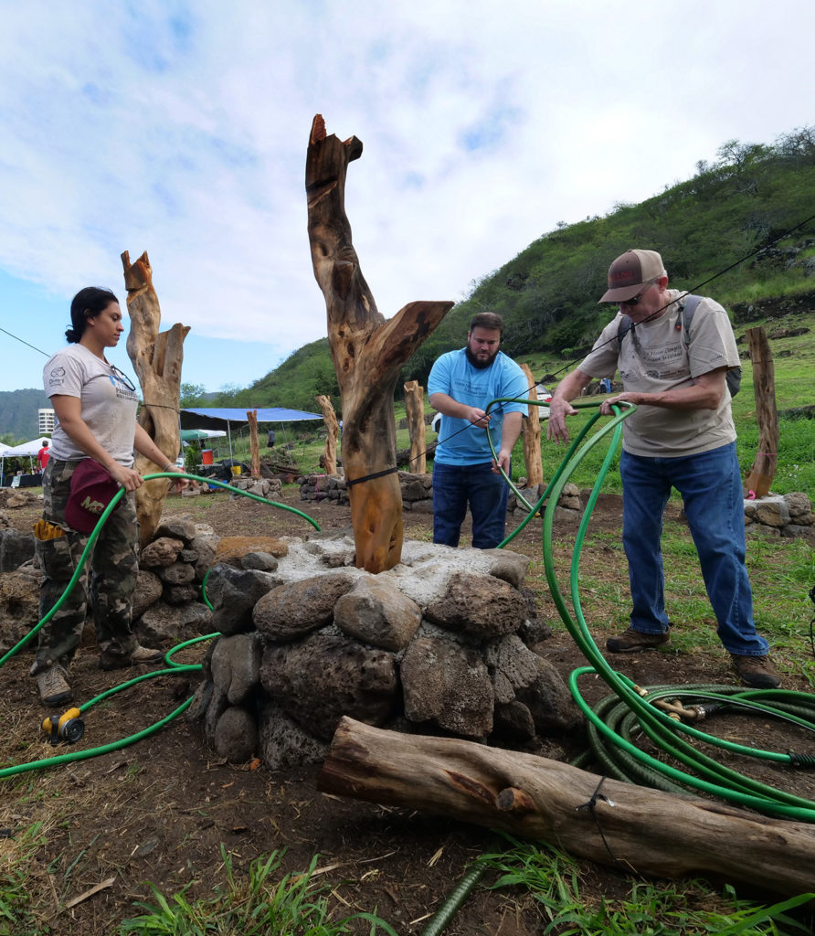 Carl Shaad (right), Ian Heilbronn (center), and Pualei Monokini-Oliveira (left) work to build a community hale at the Hawea Heiau Complex & Keawawa Wetland in Hawaii Kai, Oahu, Saturday, February 8, 2020. Community volunteers gathered there to celebrate the 2020 World Wetlands Day - one of 800 such events worldwide.  The second Saturday of every month the Keawawa heritage preserve is open from 8:30 to noon for maintenance of the wetland. The public is welcome to visit and volunteer. (CivilBeat photo Ronen Zilberman)
