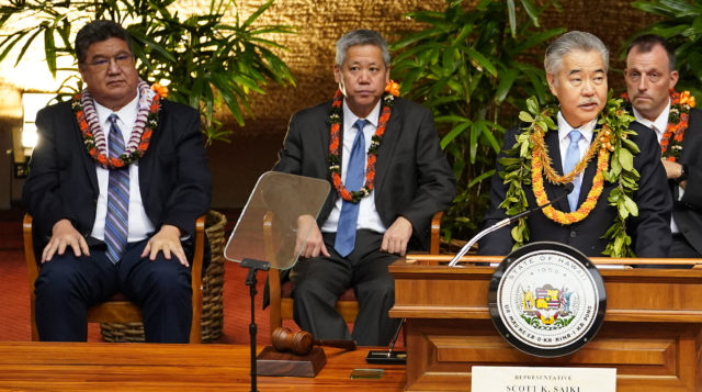 Governor David Ige gives his 2020 State of the State address at the Capitol flanked rear by left, Senate President Ron Kouchi, Speaker Scott Saiki and far right, LG Josh Green.