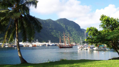 "FILE - This July 2002 file photo shows a sailing ship in the harbor at Pago Pago, American Samoa. Many residents of American Samoa are concerned that a federal judge's recent ruling in Utah, saying those born in the U.S. territory should be recognized as U.S. citizens, could threaten ""fa'a Samoa,"" the Samoan way of life, which includes cultural traditions like prayer curfews, communal living and a belief that the islands' lands should stay in Samoan hands. (AP Photo/David Briscoe, File)"