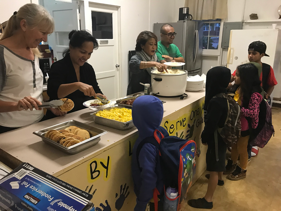 Volunteers Lisa Shin, Debbie Wheeler and Josh Ige serve a free breakfast to kids at Lanai Baptists Church. The church offers the breakfast every Wednesday.