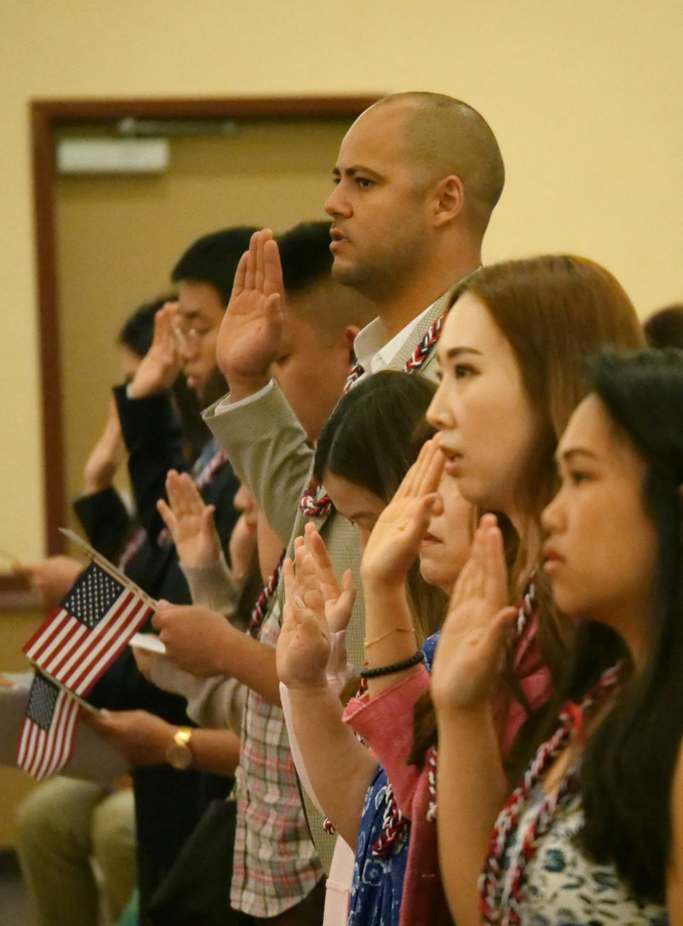 Approximately 50 citizenship applicants raised their hands to pledge allegiance and be sworn in as new US citizens during a naturalization ceremony at Iolani School in Honolulu, HI, on Wednesday, February 12, 2020.