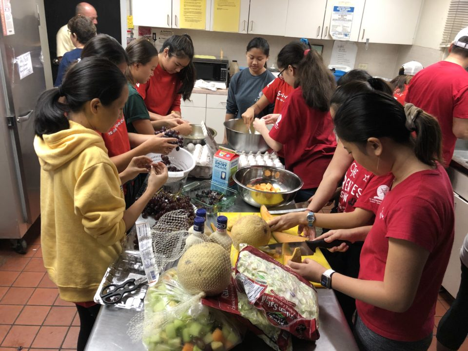 young volunteers from St. Andrew's Priory helping with the weekly Saturday hot breakfasts that St. Elizabeth's Episcopal Church provides to the hungry