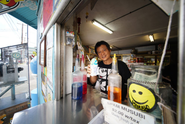 Waiola Shave Ice owner Jerry Lee peers thru the window as customers wait for the local favorites.