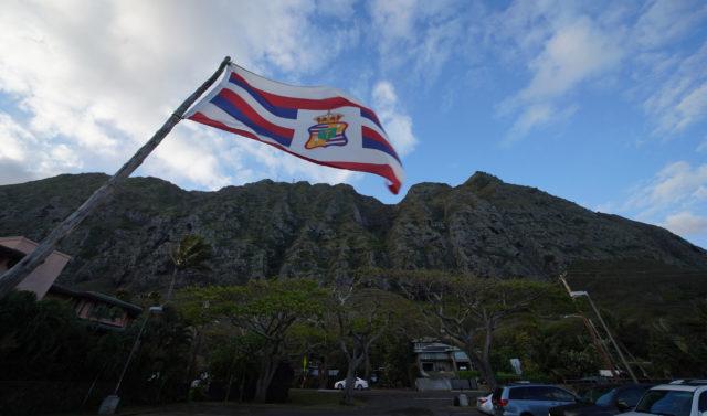Flag flies at Kaiona Beach Park with the majestic Koolau Mountains near Waimanalo.