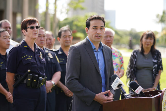 Rep Chris Lee speaks with support from HPD Chief Susan Ballard along with first responders from the police department and Honolulu Emergency Medical Services ask state lawmakers to pass four key gun violence prevention bills that would have prevented the Hibiscus Drive shootings near the Capitol.