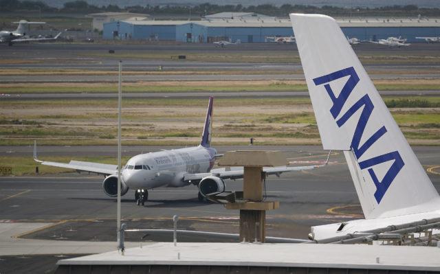 Hawaiian Airlines flight arrives at Daniel K. Inouye International Airport.