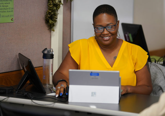 Embry Riddle Aeronautical University student Rhonda Armstead works with her 'slate' during class at Schofield Barracks.